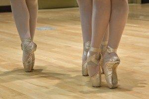 2-female-ballet-dancers-performing-on-floor